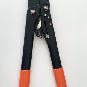 Grensax i svart metall med orange handtag i plast